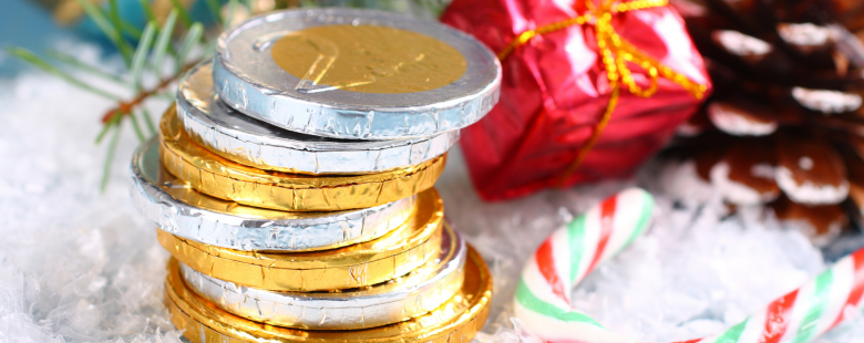 christmas chocolate coins by a christmas tree