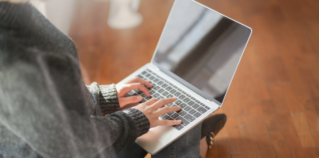 Canva Woman Typing A Business Plan On Laptop