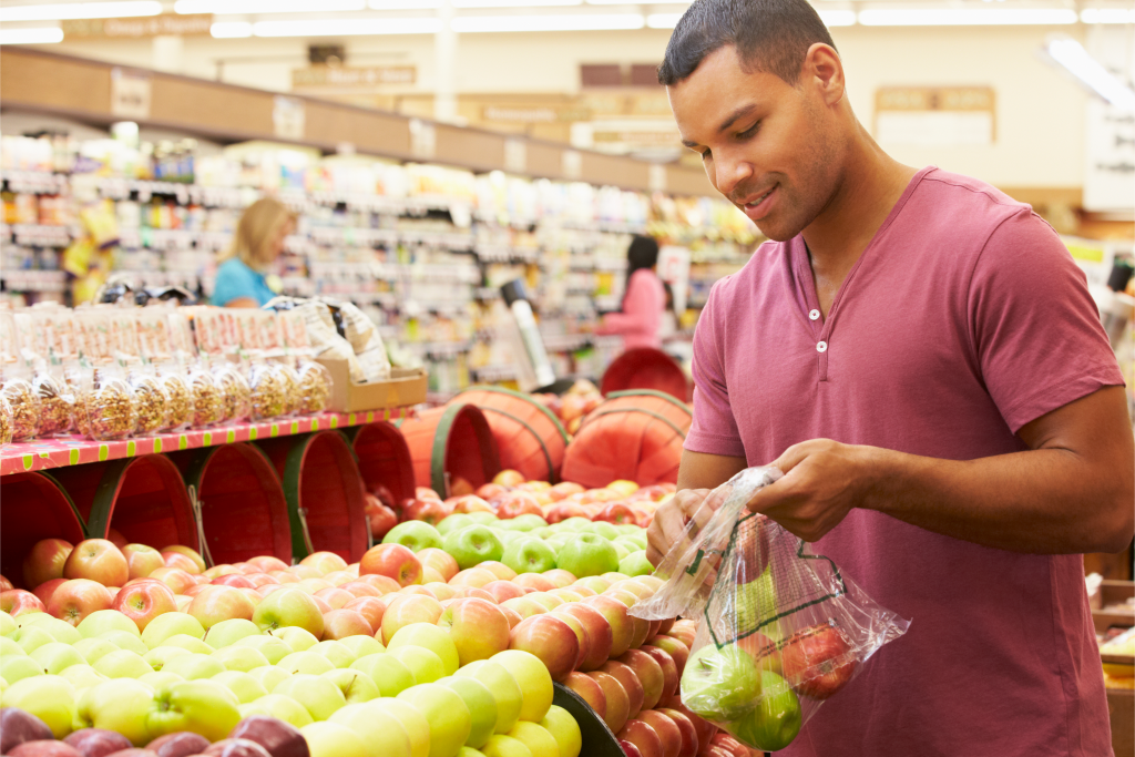 Man at Fruit Counter in Supermarket as part of consumer and shopper insights research
