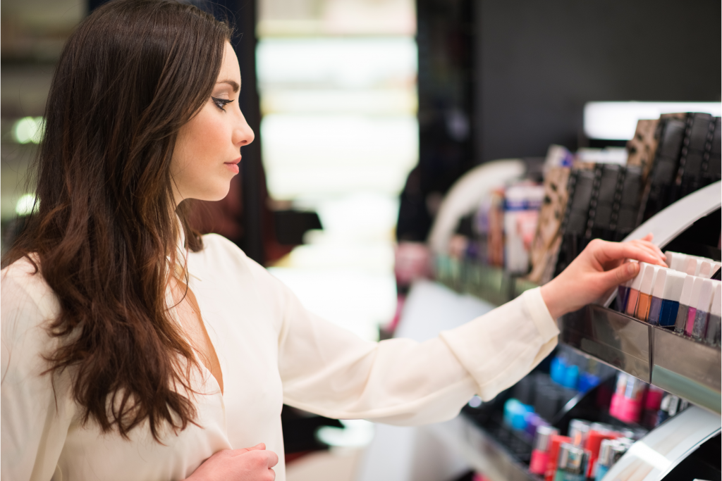 Woman shopping in a beauty shop as part of consumer and shopper insights research